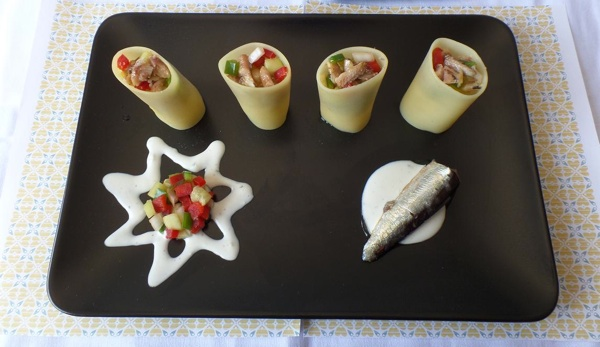 Pasta tubes stuffed with sardines and served with yoghurt sauce