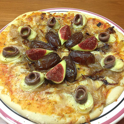 Homemade anchovy and date pizza