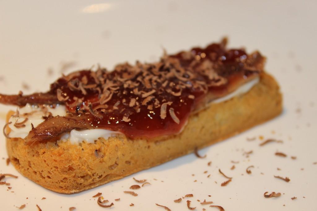 Torta del Casar, Cantabrian anchovies, strawberry jam and chocolate shavings tapa