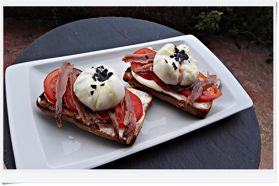 Walnut bread toast with anchovy and poached egg