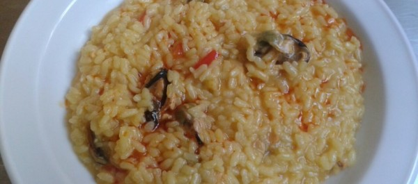 Creamy rice with mussels in brine and beer