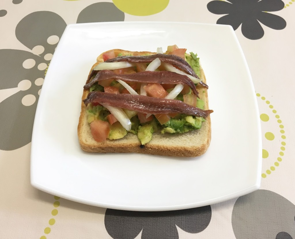 Anchovy toast with avocado and tomato