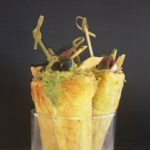 Christmas canapés: Puff pastry horns stuffed with avocado with anchovies and tuna belly