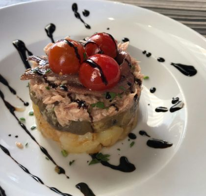 Potato, aubergine, tuna and anchovy timbale