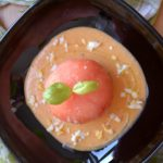 Tomato stuffed with White Tuna belly mousse on basil salmorejo