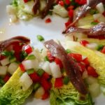 Lettuce hearts with anchovies and melon vinaigrette