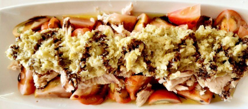 Tomato with nape of tuna and tapenade