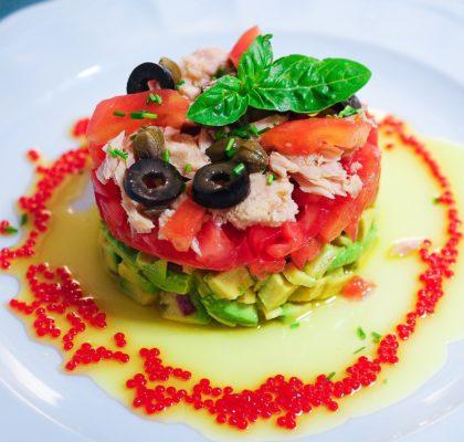 Avocado, tomato and white tuna salad in olive oil