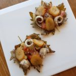 Grape leaf salad in tempura with fried banana and anchovies in vinaigrette