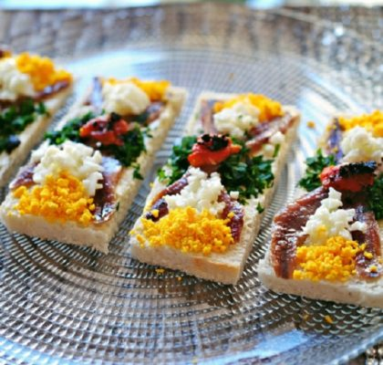 Simple Christmas Canapés with anchovy and egg