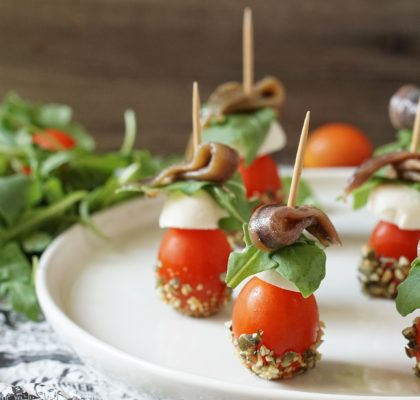 Christmas tomato, cheese and anchovy pintxo
