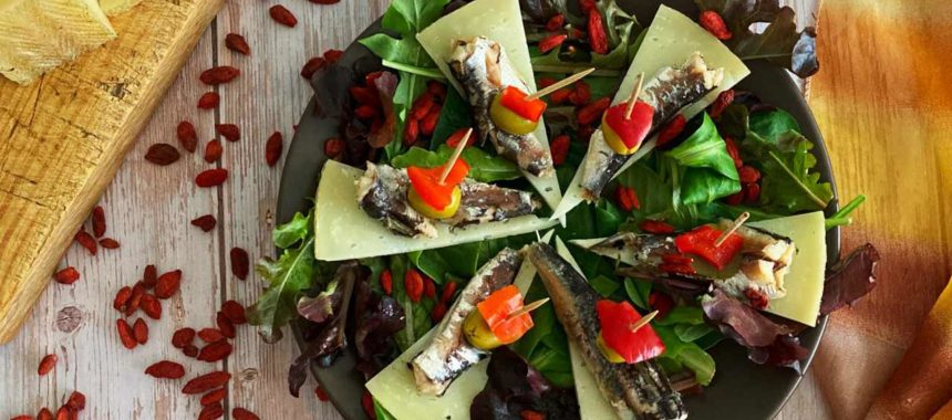 Small sardine salad with cheese