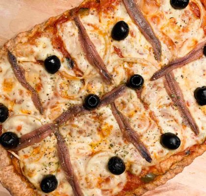Homemade spelt flour pizza with anchovies